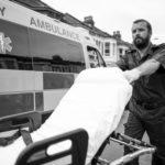 Paramedic pushing hospital bed