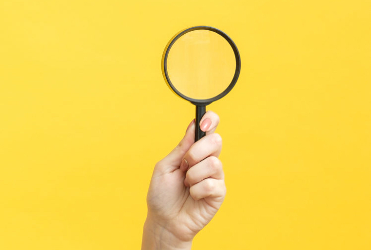 A magnifying glass to illustrate healthcare fieldwork services recruitment