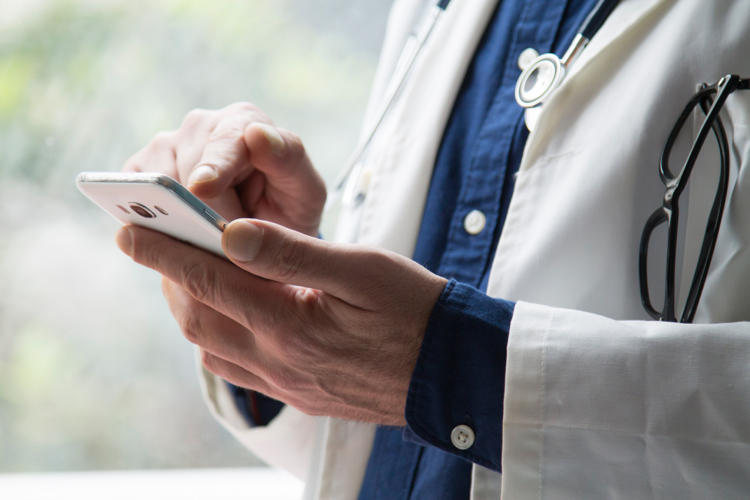 Doctor using a smartphone for a Tele-depth Interview